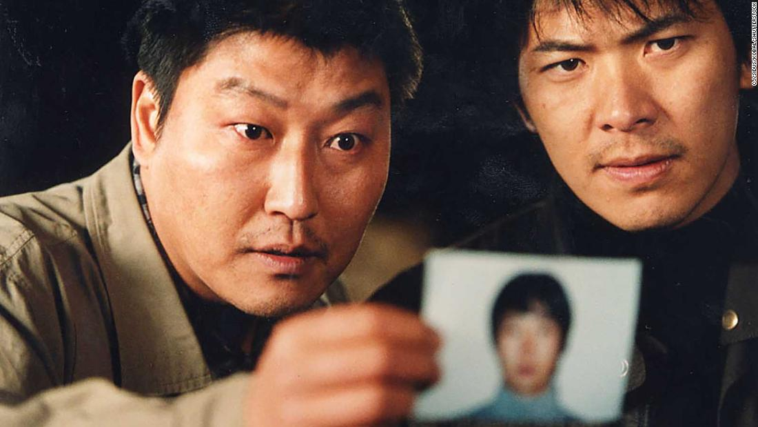 """Song Kang Ho and Kim Sang Kyung as two police detectives on the trail of an elusive killer in Bong's 2003 thriller """"Memories of Murder."""""""