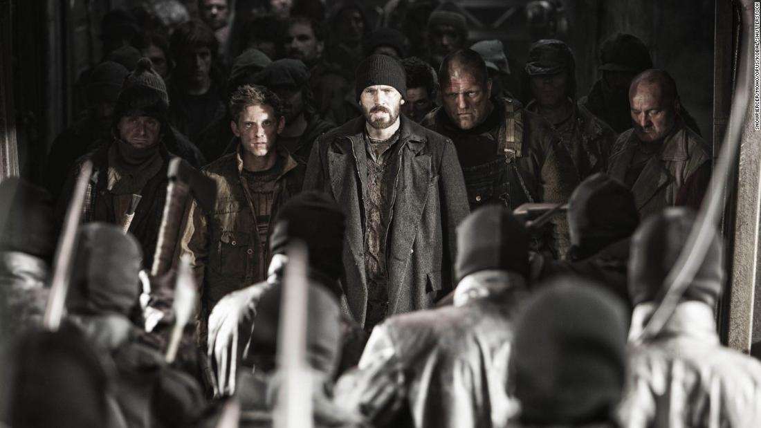 """Jamie Bell and Chris Evans in """"Snowpiercer,"""" Bong's post-apocalyptic film from 2013 in which humanity survives on an ever-moving train with a rigid class system separated by carriages."""