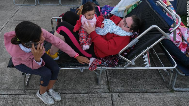 Tatiana Rodriguez, right, and family members are taking shelter at a school in Guayanilla.