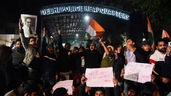 Protestors shout slogans outside the Delhi Police Headquarters following clashes between student groups at Jawaharlal Nehru University in New Delhi on Sunday, January 5. The violence injured around 34 people, according to police.