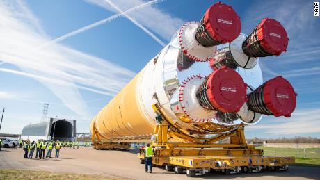 The first Artemis rocket stage is guided toward NASA's Pegasus barge on Wednesday ahead of its forthcoming journey to NASA's Stennis Space Center near Bay St. Louis, Mississippi.