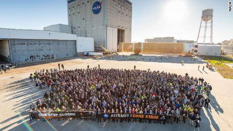 NASA, Boeing and Aerojet Rocketdyne personnel in front of the fully assembled core stage as it rolls out from Michoud to NASA's Pegasus barge on Wednesday.
