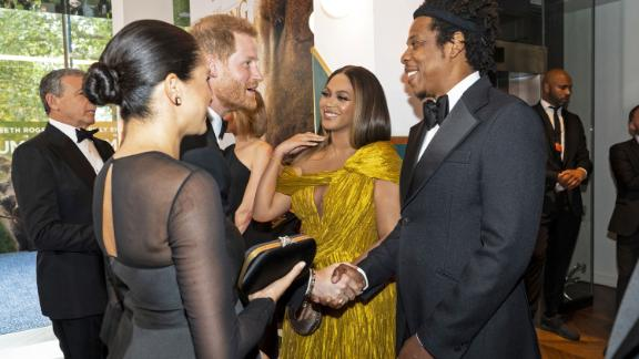 "Harry and Meghan greet singer Beyoncé and her husband, rapper Jay-Z, as they attend the European premiere of the film ""The Lion King"" in July 2019."