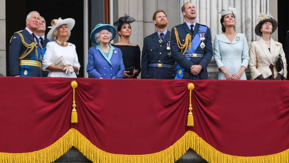 Members of the royal family watch a flyover during a July 2018 event marking the centenary of the Royal Air Force. From left are Prince Charles; Prince Andrew; Camilla, the Duchess of Cornwall; Queen Elizabeth II; Meghan, the Duchess of Sussex; Prince Harry; Prince William; and Catherine, the Duchess of Cambridge.