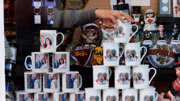 A shop worker in Windsor, England, adjusts memorabilia celebrating the engagement of Harry and Meghan. Their engagement was announced in November 2017.
