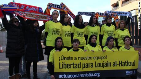 Women from Amnesty International protest outside the Saudi embassy in Madrid.