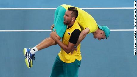 Australia's Alex de Minaur and Nick Kyrgios celebrate beating Britain in the quarterfinals of the ATP Cup.