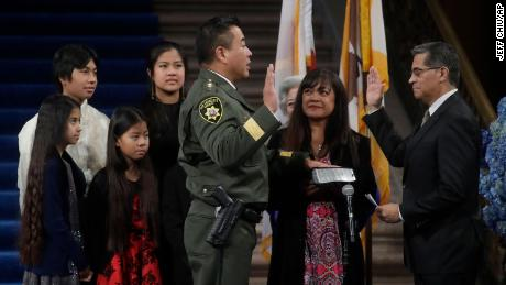 His family watches as Miyamoto is sworn in by California Attorney General Xavier Becerra.