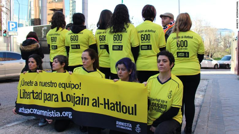 Amnesty International protesters wear the No. 600 on their shirts, the number of days Loujain al-Hathloul had been in prison.