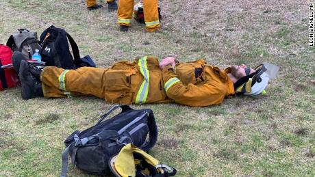 Photographs show Australian firefighters who are exhausted at rest due to fighting forest fires