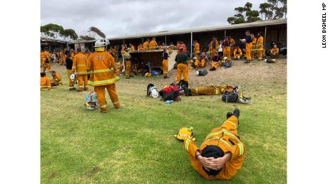 Firefighters relax between shifts battling the bushfires.