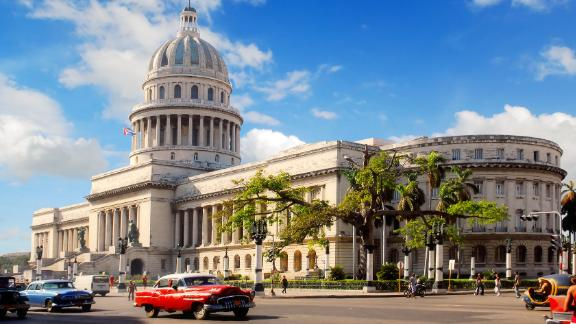 "Can Americans travel to Cuba? Yes, but it's not easy. There are 12 categories of allowable US travel to Cuba, including ""Support for the Cuban People"" trips. Shown here is Havana's Capitol building, which was built in the 1920s and was modeled after the US Capitol."