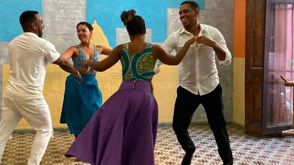 Dancing in Havana. Members of a Friendly Planet tour visit La Casa del Son to watch these dance instructors demonstrating their their salsa, cha-cha and mambo moves and dance with them.