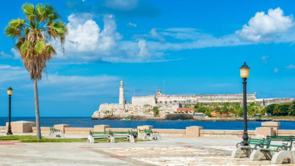 An island view. This Havana park has an incredible view of the castle and lighthouse of El Morro.