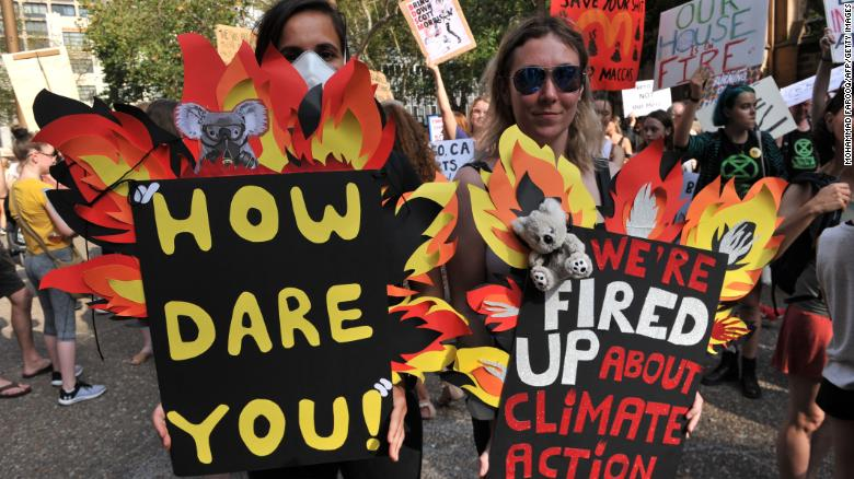 Tens of thousands of Australians rallied across cities as deadly climate-fuelled bushfires swept across the continent.