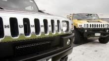LIBERTYVILLE, IL - MAY 17: Hummer H2s sit on the lot of Weil Hummer May 17, 2004 in Libertyville, Illinois. Faced with slumping sales G.M. has started offering rebates on the mammoth SUVs which average a mere 11 miles per gallon of gas. (Photo by Scott Olson/Getty Images)