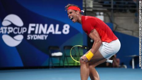 Rafael Nadal rallied to set up a 55th meeting with Novak Djokovic at the ATP Cup finals.