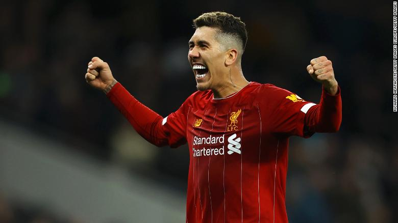 Roberto Firmino celebrates another landmark goal for Liverpool against Tottenham.