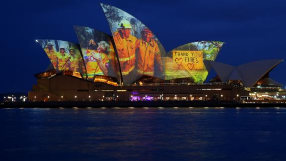 Pictures of firefighters are projected onto the Sydney Opera House on January 11.