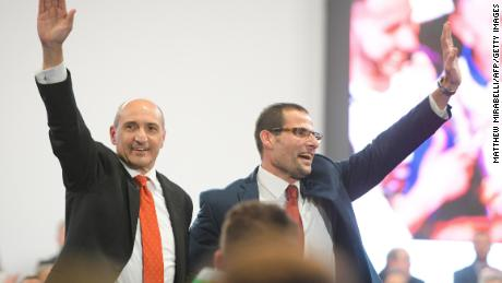 Labour Party leader candidates Chris Fearne (left) and Robert Abela (right) wave to delegates before the vote.