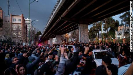 Demonstrators chant during a vigil for the victims of the Ukraine airliner crash in Tehran on January 11.