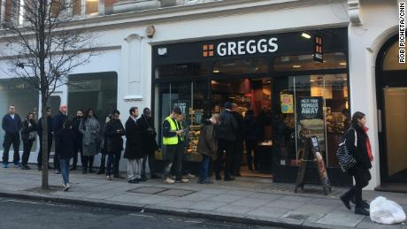 Customers are queuing in front of a London Greggs at lunchtime.