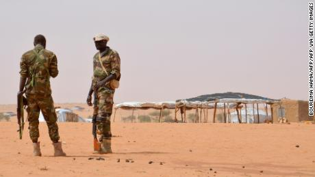 Niger soldiers stand guard at the Tazalit United Nations refugee camp in the Tahoua region