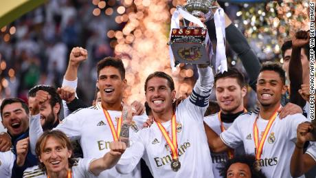 Real Madrid captain Sergio Ramos raises the cup after a penalty.