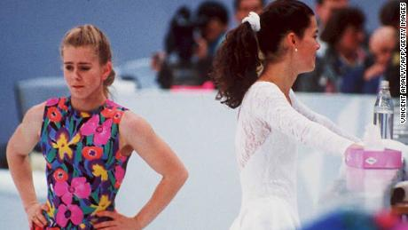 US figure skaters Tonya Harding, left, and Nancy Kerrigan avoid each other during a training session on February 17, 1994, during the Lillehammer Winter Olympics.