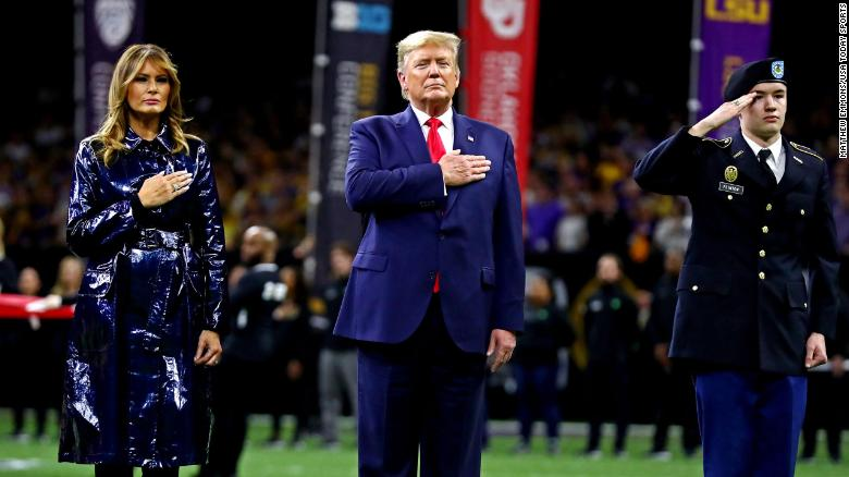President Trump and first lady Melania Trump on the field before the game.