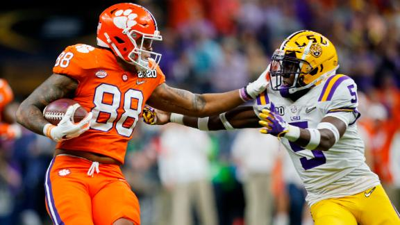 Clemson tight end Braden Galloway is tackled by LSU safety Marcel Brooks.