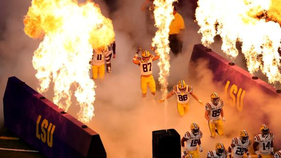 LSU players run onto the field prior to the start of the game.
