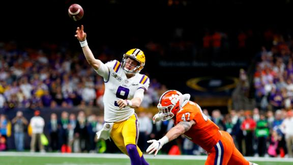 Burrow is pressured from Clemson linebacker James Skalski. After a slow start, Burrow threw for three touchdowns and ran for one in the first half.