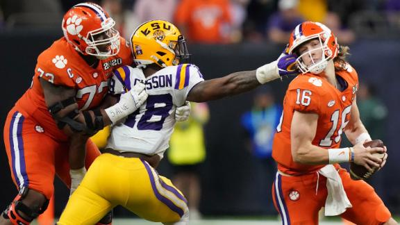 LSU linebacker K'Lavon Chaisson grabs Lawrence's face mask in the third quarter.