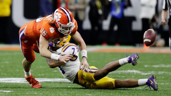 LSU safety Grant Delpit forces a late-game fumble by Clemson quarterback Trevor Lawrence. The turnover essentially sealed the game.