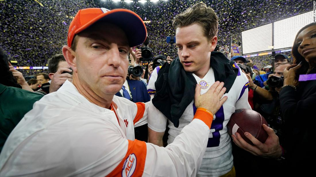 Clemson head coach Dabo Swinney congratulates Burrow after the final whistle.