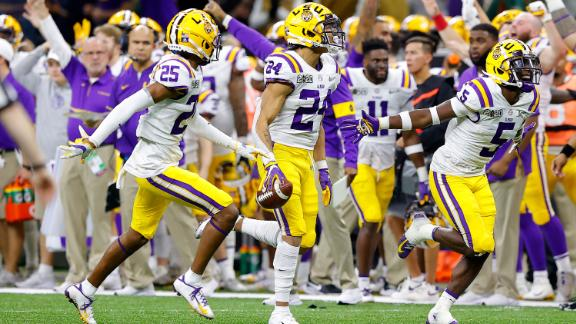 LSU players react after Lawrence's fumble.