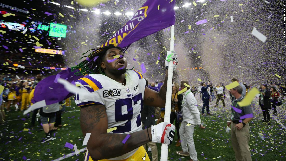 LSU defensive end Glen Logan celebrates as confetti falls in the Superdome.