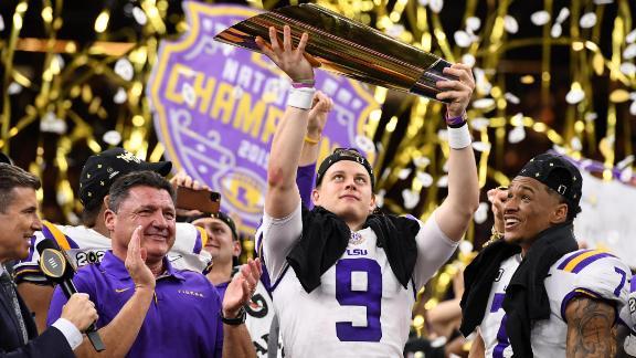LSU quarterback Joe Burrow lifts the trophy after Monday night's win over Clemson.