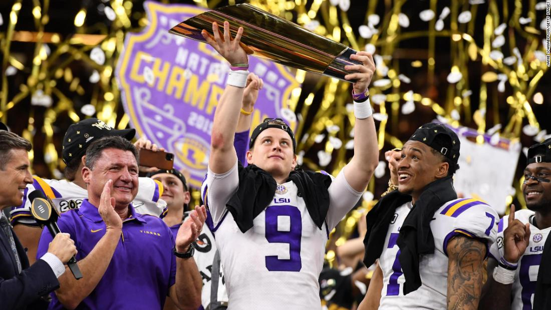 LSU quarterback Joe Burrow lifts the trophy after Monday night's win over Clemson.