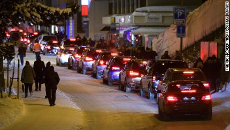 Cars line up in Davos, Switzerland on the opening day of the World Economic Forum in 2017.