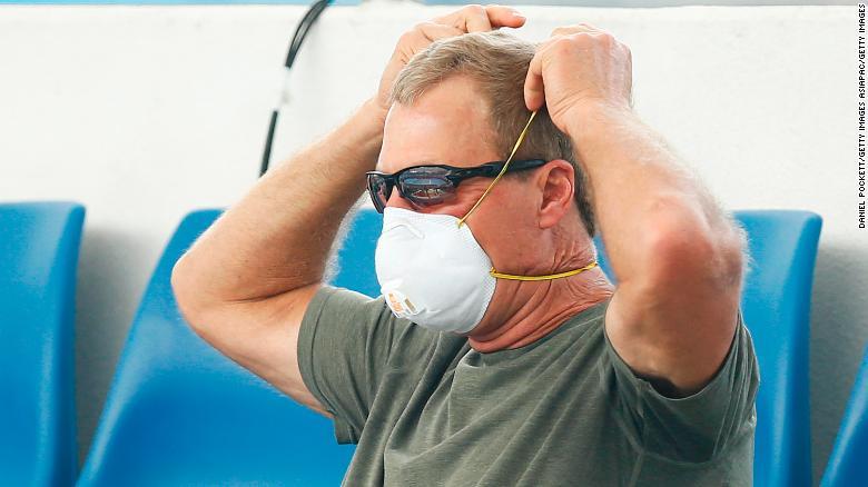 A fan wears a respiratory mask during Australian Open qualifying matches.