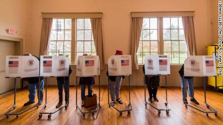 Voters fill out their ballot papers in a polling station in Virginia in 2018.