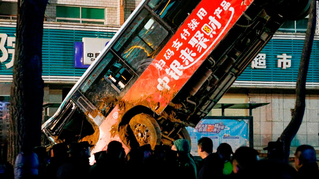 Enormous sinkhole swallows bus and passengers in China, killing at least 6 people
