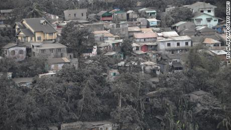 Houses with roofs covered with ash, spewed by Taal volcano in Tagaytay city, south of Manila on January 14, 2020.