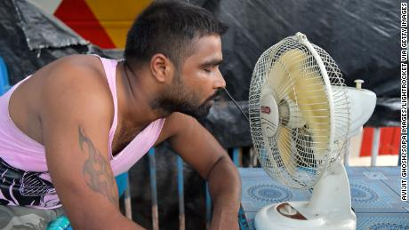 A man tries to cool himself during a heat wave in 2019 in Kolkata, India.