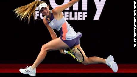 "Caroline Wozniacki attempts a ""tweener"" (between the legs shot) during the Rally for Relief charity match in Melbourne"