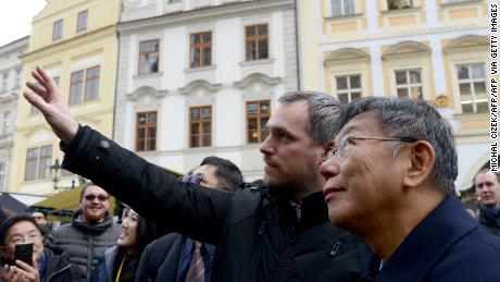 The mayors of Prague and Taipei walk through Prague's Old Town Square on January 13, 2020.