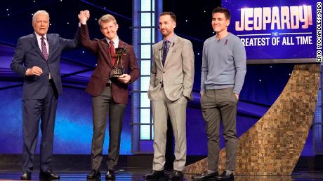 """Jeopardy!"" host Alex Trebek with champion Ken Jennings and runners-up Brad Rutter and James Holzhauer."