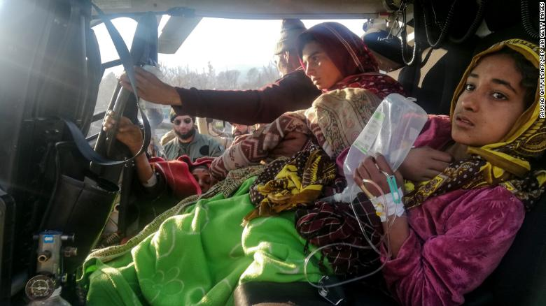 Injured avalanche victims arrive in in Muzaffarabad in an army helicopter following heavy snowfall in the Neelum Valley, in Pakistan-administered Kashmir on January 14, 2020.